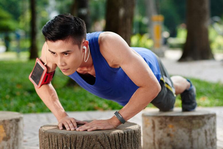 Sweaty determined sportsman doing push-ups