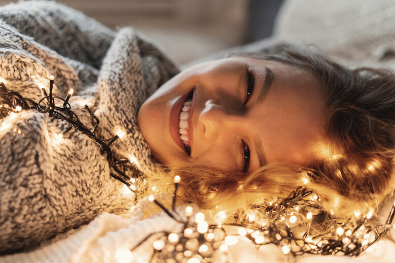 Beautiful woman lying down surrounded by lights