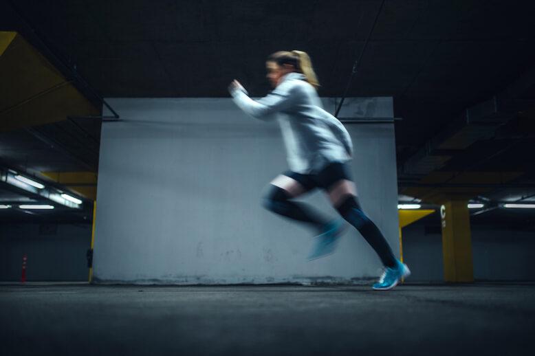 Female running at underground parking