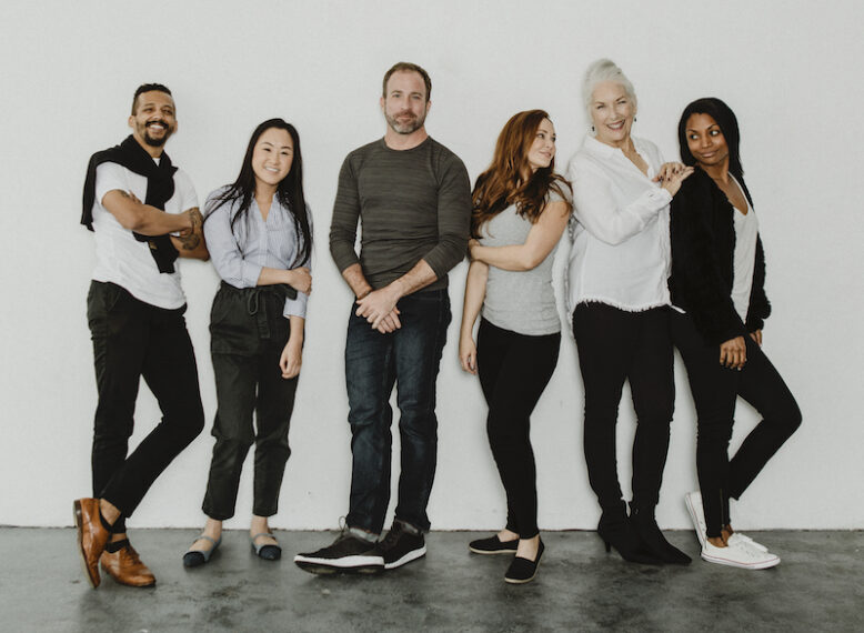 Group of cheerful diverse people in a white room