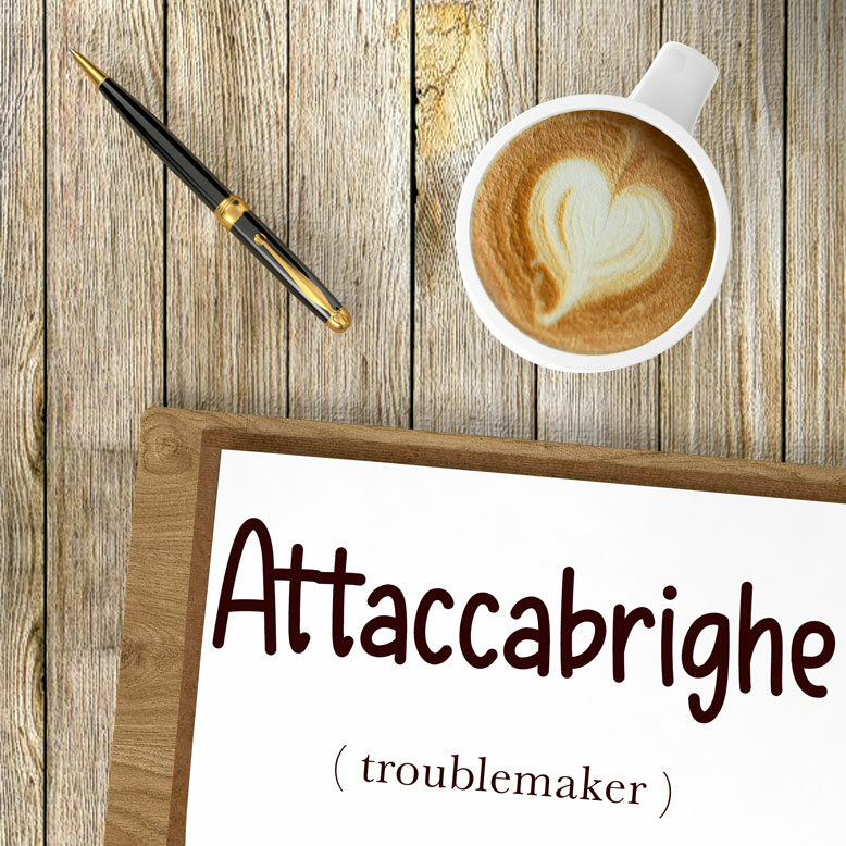 """cover image with the word """"Attaccabrighe"""" and its translation written on a notepad next to a cup of cofee"""