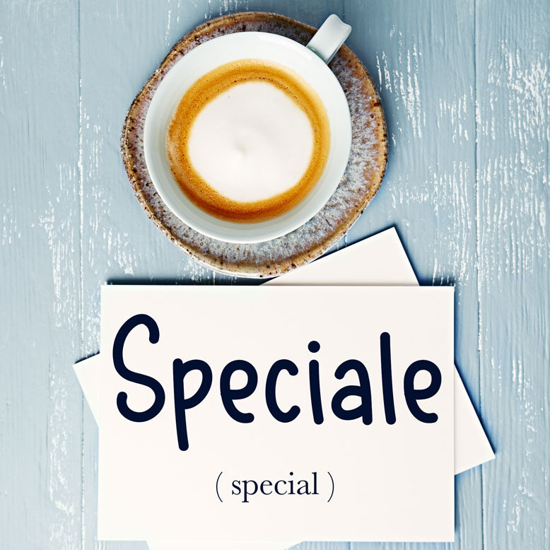 """cover image with the word """"speciale"""" and its translation written on a notepad next to a cup of cofee"""