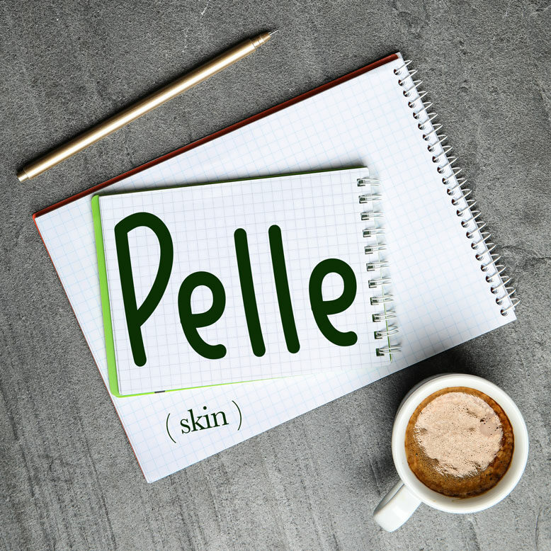 """cover image with the word """"pelle"""" and its translation written on a notepad next to a cup of cofee"""