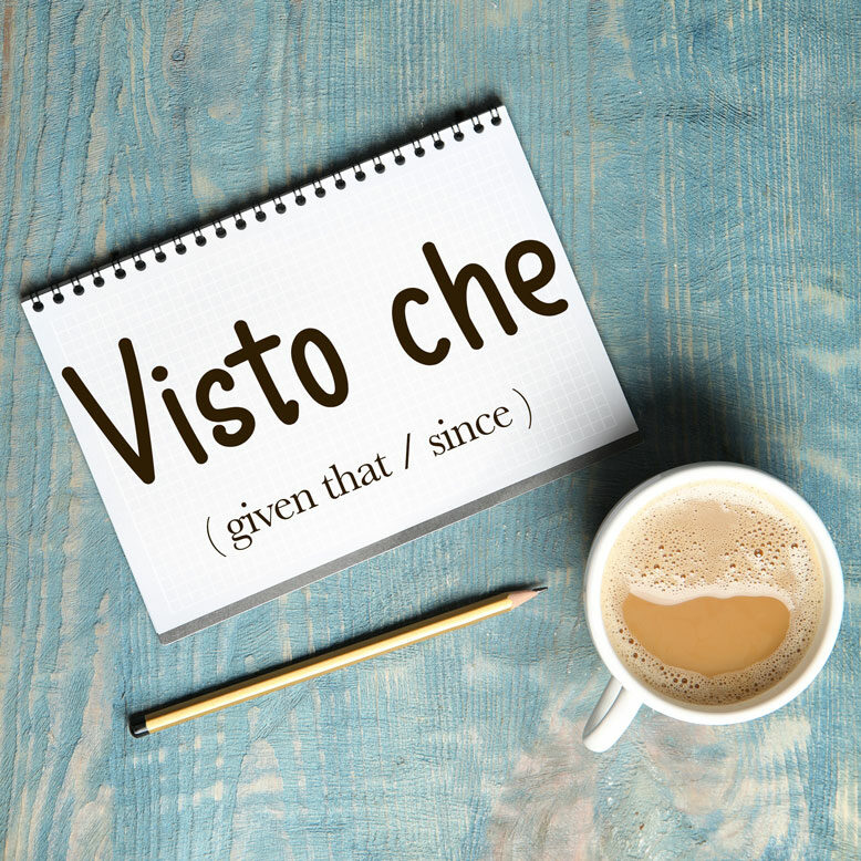 """cover image with the word """"visto che"""" and its translation written on a notepad next to a cup of cofee"""