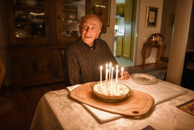 A happy senior celebration 80 with his favorite birthday pie.