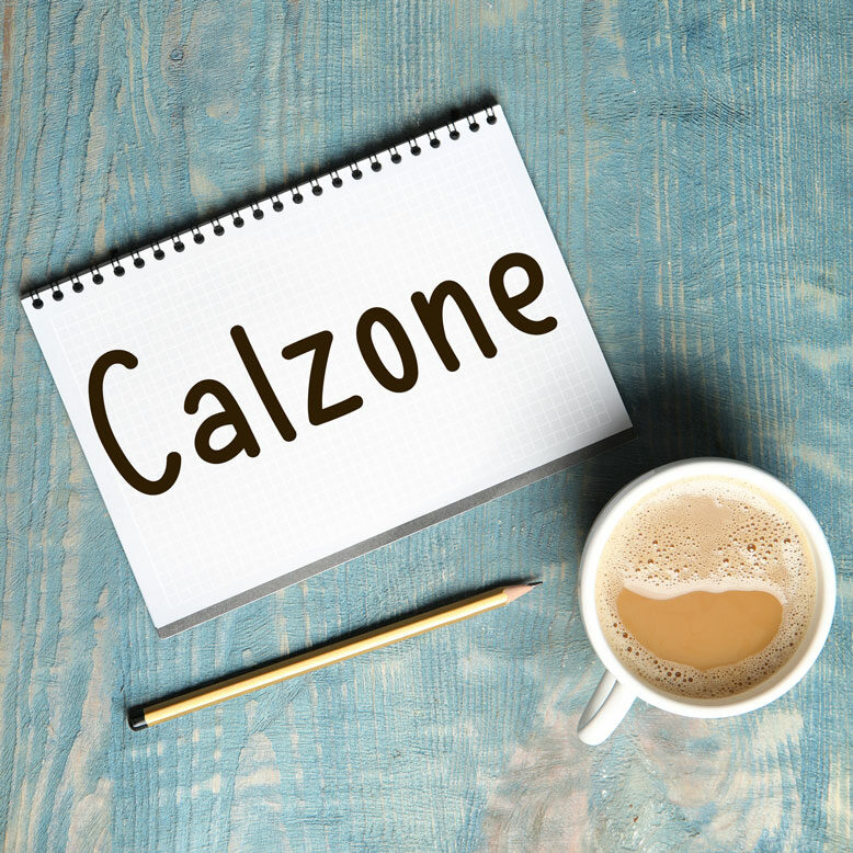 """cover image with the word """"calzone"""" written on a notepad next to a cup of cofee"""