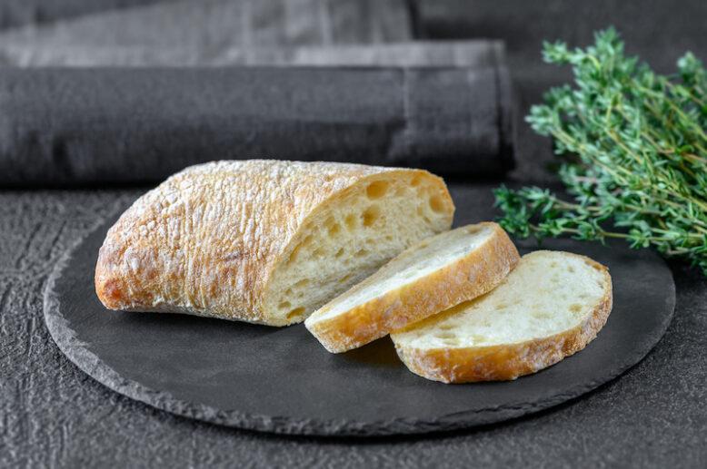 ciabatta bread sliced on a stone plate