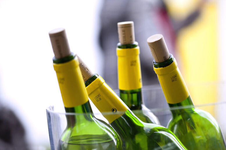 Close up of bottles of wine in a bucket