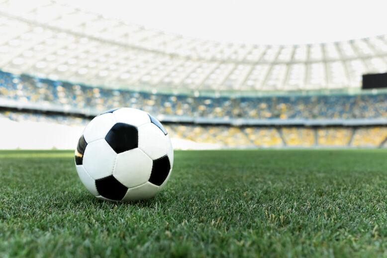 football on the field inside the stadium