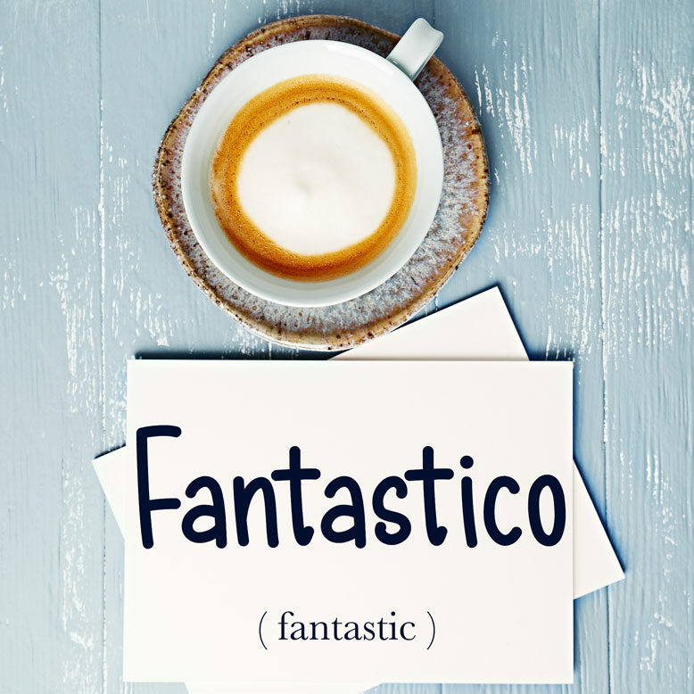 """cover image with the word """"fantastico"""" and its translation written on a notepad next to a cup of cofee"""