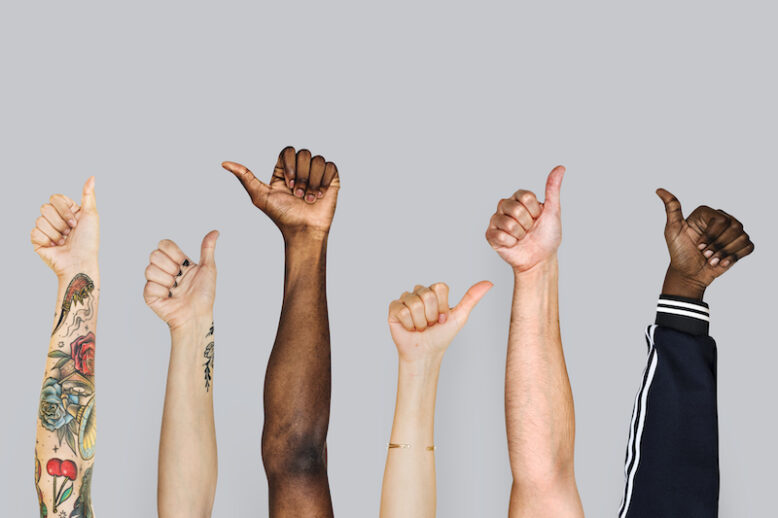 various hands with thumbs up