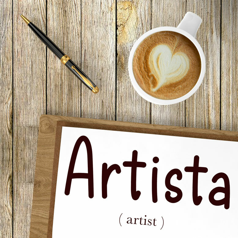"""cover image with the word """"artista"""" and its translation written on a notepad next to a cup of cofee"""