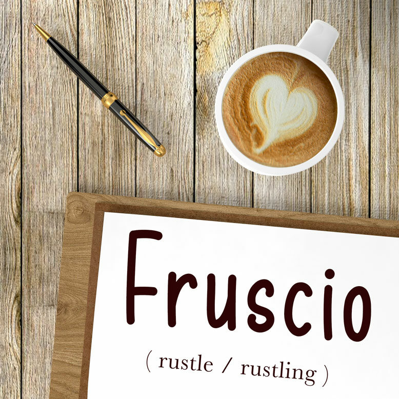 """cover image with the word """"fruscio"""" and its translation written on a notepad next to a cup of cofee"""