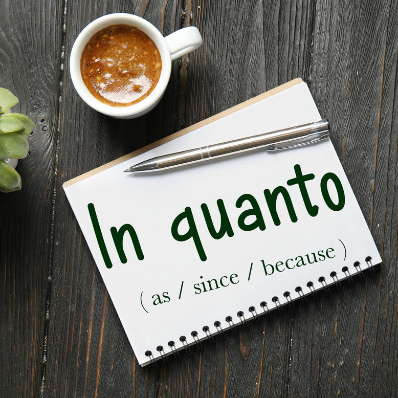 """cover image with the words """"in quanto"""" and its translation written on a notepad next to a cup of coffee"""