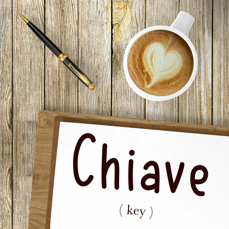 """cover image with the word """"chiave"""" and its translation written on a notepad next to a cup of coffee"""